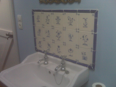 blue delft flower tiles form a pretty splashback for french house